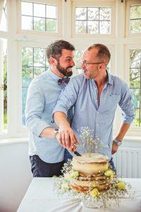 Tamworth, Staffordshire wedding photographer, cutting of the wedding cake