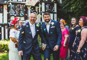 Tamworth, Staffordshire wedding photographer, gay wedding at Nailcote Hall Hotel in Coventry, the confetti walk through photo, smiles from everyone